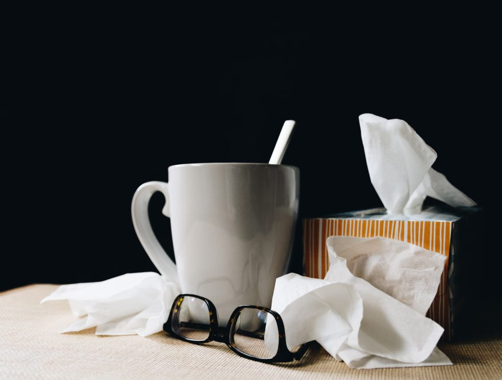 A cup of tea, tissues, and glasses