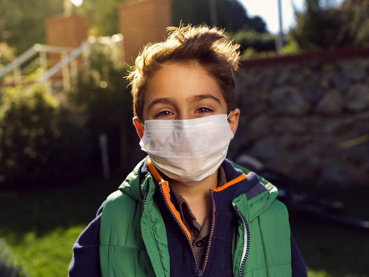 Boy smiling with his mask on